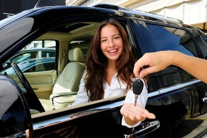 businesswoman receiving keys of her new off-road car